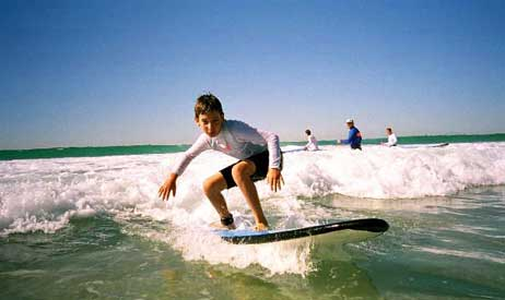 Catch a wave while taking a surfing lesson on the beautiful Gold Coast!